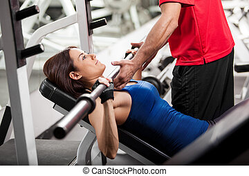 You can do this - Personal trainer helping a young woman...