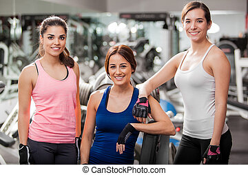Female friends working out together - Group of cute young...