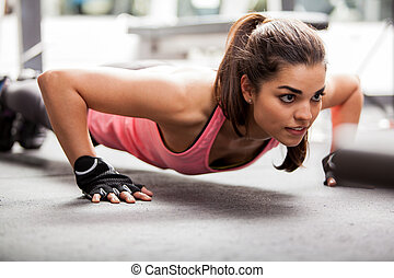 Doing some push ups at the gym