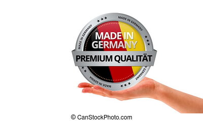 Made in Germany - A person holding a Made in Germany sign