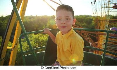 little boy on the Ferris wheel