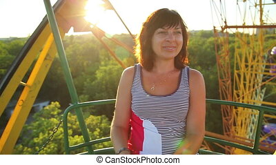 little boy with her mother on the Ferris wheel