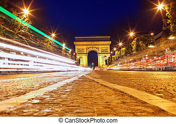 Evening on Champs-Elysees in front of Arc de Triomphe.Paris....