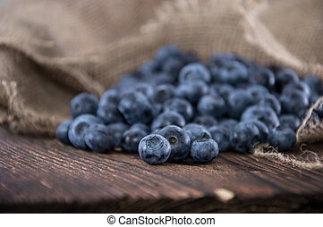 Blueberries on an old wooden table