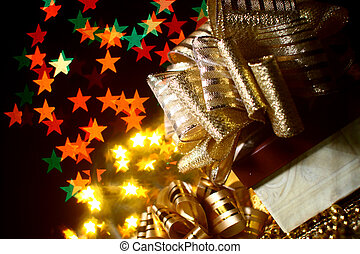 holiday gifts - the holiday gifts over warm stars background