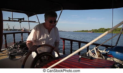 adult man driving a boat 1 - adult man driving a boat