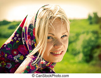 Portrait beautiful girl in kerchief on background of t rural...
