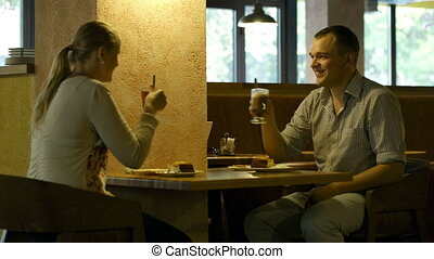 Young couple in a cafe.