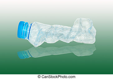 empty used plastic bottles on green background