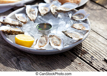 raw oysters - fresh raw oysters served with lemon and sauce...