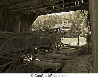 Old Farm Wagon - A sepia toned photo of an old farm wagon in...