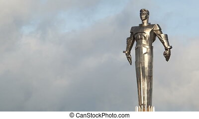 Time lapse of clouds running behind Yuri Gagarin monument. -...