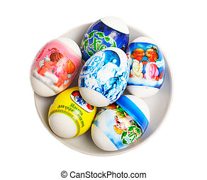 Easter eggs on a plate are isolated on a white background
