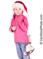 Cute little girl with figure skates
