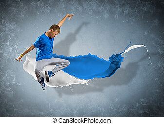 male dancer with splashes of paint - male dancer jumped...