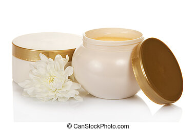 face creams and flower - Two cosmetic a face creams and...