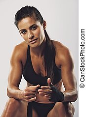 Female boxer wearing strap on wrist - Beautiful young female...