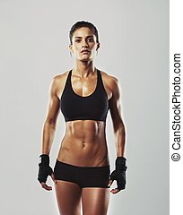Tough young woman with muscular body - Tough young woman...