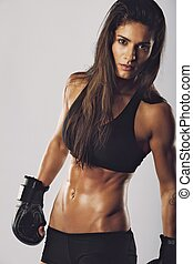 Kickboxing fighter with an intense look - Female kickboxing...