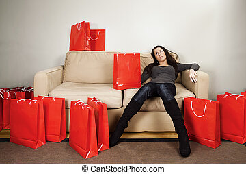 Shopping exhaustion - A female in her 20\'s resting from a...