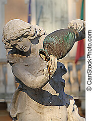 Statue of a fountain while ago spouting water from the jug