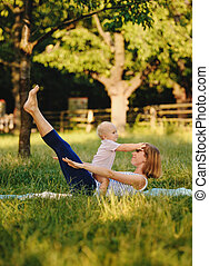 Mother and her daugther practice yoga