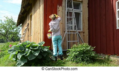 painter woman paint wall