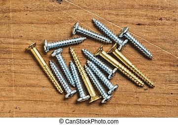 Assorted screws on wood. - Assorted screws on wood, close up...