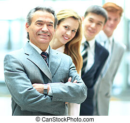 Group of business people with businessman leader on...