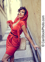 Beautiful woman in urban background. Vintage style -...