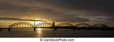The railway bridge in Riga on the dawn