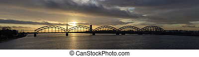 bridge at sunset - The railway bridge in Riga on the dawn