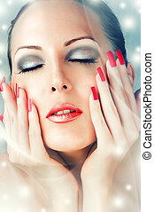 Winter Skin Care. Beautiful female face with red lips and...