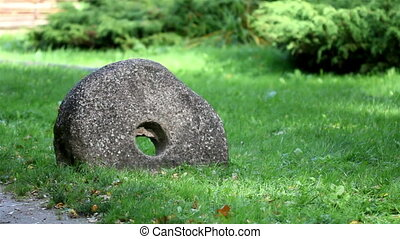 Hole in the middle of the millstone grindstone rock - Hole...