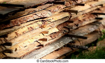 Wood sawmatrial planks piled - Wood planks piled. The wood...