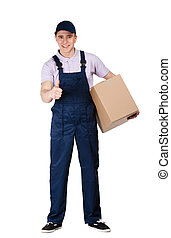 Workman in overalls hands a parcel box - Workman in overalls...