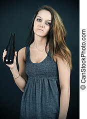 Unhappy young woman addict - Alcohol or drug abuse concept:...