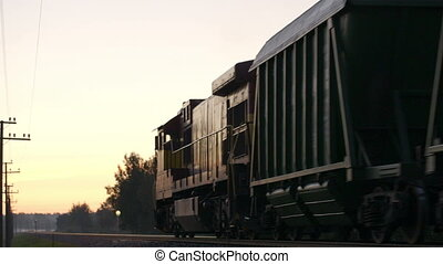 Freight train passing by in the countryside. - Freight train...