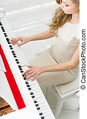Top view of pianist playing piano - Top view of woman...
