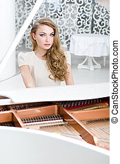Portrait of woman sitting at the piano - Portrait of woman...