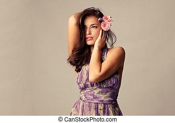 elegant sensual woman  with roses in hair studio shot