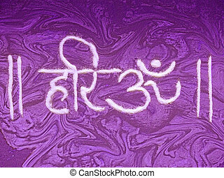 A holy sign or letter called Hari Om is made by Rangoli