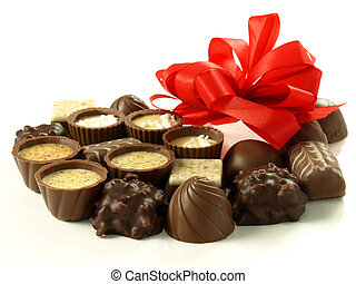 Sweet gift - Delicious pralines for a gift on white studio...