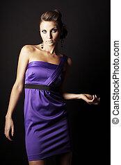 brunette fashion girl in violet dress