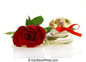 Bud of red rose and bottle spirits - Bud of a red rose and a...