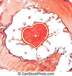 Grapefruit in shape of heart and juice splash isolated on...