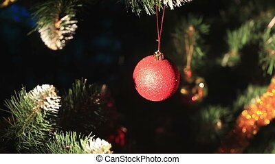 Decorating a Christmas tree - Iridescent toy ball on the...