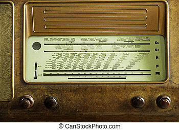 vintage radio of the last century with the knobs to adjust...