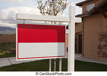 Blank Real Estate Sign in Front of House