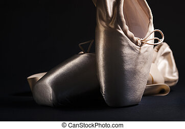 Pointe Shoes - Pointe shoes over black background